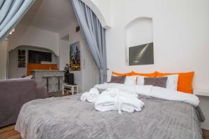 Cama o camas de una habitación en Family Apartman Belgrade