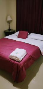 A bed or beds in a room at Pista Q