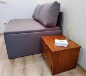 A seating area at Сozy Kiev Apartment str Chernovola