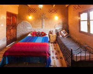 Cama o camas de una habitación en Auberge Afoud
