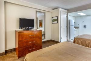 A television and/or entertainment center at Quality Inn & Suites Oceanblock