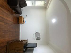 A television and/or entertainment center at Classic 3 bedrooms House close to CBD of Parramatta & Olympic Park