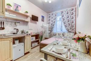 Кухня или мини-кухня в Bolshaya Posadskaya 9/5