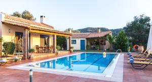 The swimming pool at or near Villa Givera