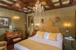 מיטה או מיטות בחדר ב-Boutique Hotel Campo de' Fiori