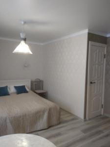 Кровать или кровати в номере Апартаменты на Франциска Скорины 26