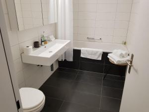 Ein Badezimmer in der Unterkunft Paradeplatz Apartment by Airhome
