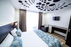 Кровать или кровати в номере Гостевой дом Елена на улице Шмидта