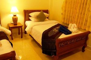 A bed or beds in a room at Katanoi Resort