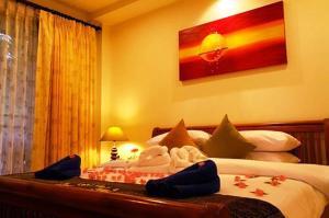 Кровать или кровати в номере Katanoi Resort