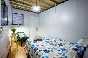 A bed or beds in a room at Casa Santurce