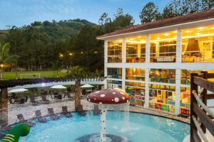 The swimming pool at or near Vale Suíço Resort