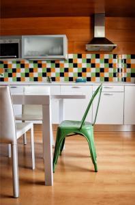 A kitchen or kitchenette at Apartamentos María Luisa