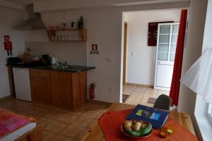 A cozinha ou cozinha compacta de Apartamento Alegre