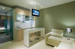 A television and/or entertainment center at Ako Suites Hotel