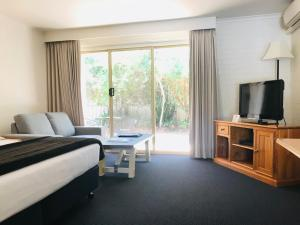 A television and/or entertainment center at Nagambie Motor Inn and Conference Centre