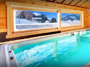 The swimming pool at or near Chalet Flocon Magique - OVO Network