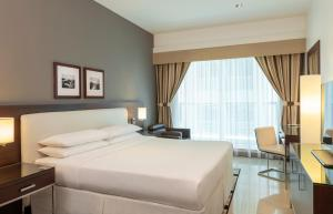 A bed or beds in a room at Four Points by Sheraton Sheikh Zayed Road