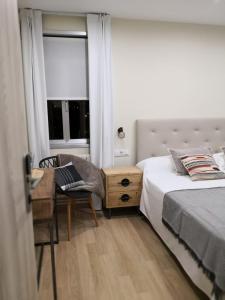 Ein Bett oder Betten in einem Zimmer der Unterkunft A Torre do Lago