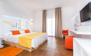 Cama o camas de una habitación en Globales Cortijo Blanco