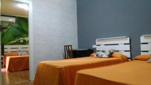 A bed or beds in a room at Hostal Escala Luna