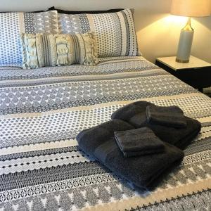 A bed or beds in a room at Tic Tac Toe Quality Accommodation