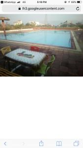 A view of the pool at Ankit villa or nearby
