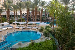 The swimming pool at or near Herods Vitalis Spa Hotel Eilat a Premium collection by Fattal Hotels