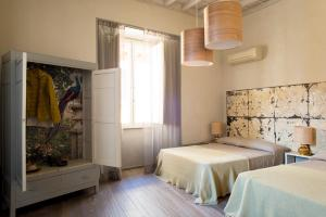 A bed or beds in a room at CasaCau