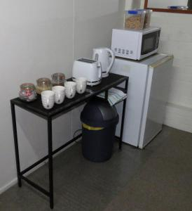 A kitchen or kitchenette at Homestay Guest Suite