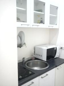 O bucătărie sau chicinetă la Phuket Arkadia Villa