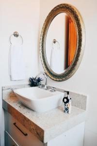 A bathroom at Flat's Refúgio Vip