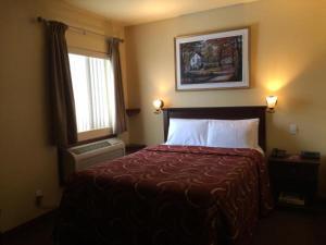 Un ou plusieurs lits dans un hébergement de l'établissement Hotel Citadelle