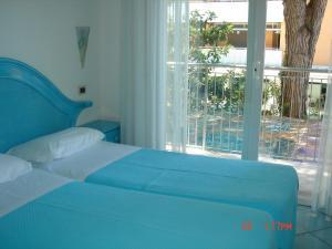 Postel nebo postele na pokoji v ubytování Hotel Da Giovanna
