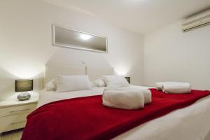 A bed or beds in a room at Apartments Gajeta