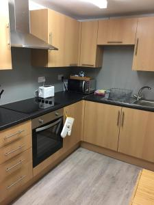 A kitchen or kitchenette at Lunan House Hotel