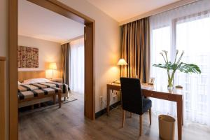 A bed or beds in a room at relexa hotel Stuttgarter Hof