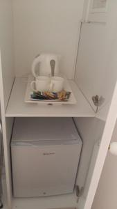 A kitchen or kitchenette at NN Luxury Room near Athens Airport