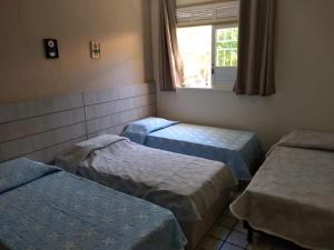 A bed or beds in a room at Casa na praia de Atalaia