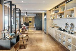 A restaurant or other place to eat at Novotel Jakarta Mangga Dua Square