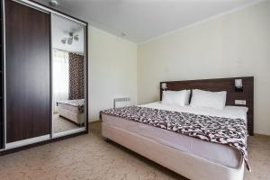 A bed or beds in a room at HAILEY airport hotel Begishevo