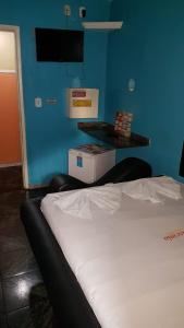 A bed or beds in a room at Hotel fascinio (Adult Only)