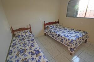 Cama ou camas em um quarto em Chácara Tangará