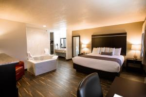 A bed or beds in a room at Ten Pin Inn & Suites