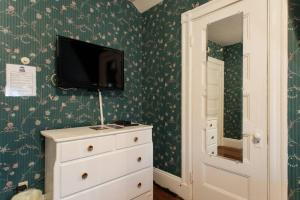 A television and/or entertainment center at The Coolidge Corner Guest House: A Brookline Bed and Breakfast