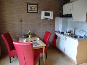 Küche/Küchenzeile in der Unterkunft Claes Compaen