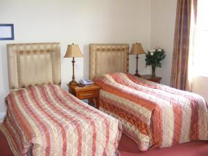 A bed or beds in a room at The Town Hotel