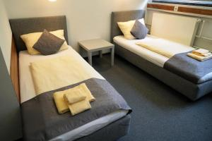 A bed or beds in a room at CREO Munich City
