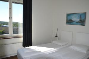 A bed or beds in a room at Sidsjö Hotell & Konferens