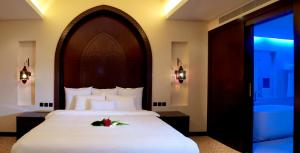 A bed or beds in a room at Ista Suites Seef